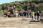 Attendees line up to operate this Cat 323F excavator equipped with Trimble technology.