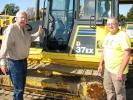 Darrell Harp (L) and Dewey Garner, both of Darrell Harp Enterprises, a manufacturer-distributor of a wide variety of 3-point hitch equipment, Red Bay, Ala., shop the selection of dozers, including this Komatsu D37EX.