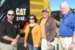 (L-R): Casey Clayton, Thompson Machinery; Brandy Settlemires and Buz Plaxico, both of Buz Plaxico Dozer Service, Corinth, Miss.; and Jim Simmons, Thompson Machinery, discuss some of the machines on display.