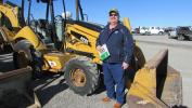 Jeff Isom of the Roper Corporation in Odessa, Texas, plans to win the bid on this Cat 420E backhoe.