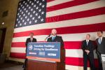 Troy Davidson, a driver for Werner Enterprises, accepts the top rookie military driver award at the Transition Trucking: Driving For Excellence award ceremony at the U.S. Chamber of Commerce in Washington, D.C., as (from left to right) Eric Eversole, president Hiring Our Heroes, and vice president, U.S. Chamber of Commerce, Brad Bentley, FASTPORT president, and Kurt Swihart, Kenworth marketing director, watch. Photo courtesy of Joshua Roberts /U.S. Chamber of Commerce.