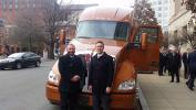 Troy Davidson, a driver with Werner Enterprises and a decorated former crew chief with the Blue Angels, stands with Kurt Swihart, Kenworth marketing director, in front of the Kenworth T680 with 76-inch sleeper Davidson was awarded as the top rookie military driver.