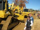 Registered bidders take one final look at the dozers that are lined up and ready to roll across the ramp.
