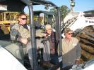 (L-R): George Jackson, contractor based in Villa Rica, Ga., and Andy Harper and Randy Harper, both of Affordable Home Renovations, Carrollton, Ga., test operate a Bobcat mini-excavator.