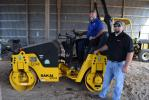 Todd Adams (L), public works supervisor of Putnam County, receives instruction on the county's Sakai SW354 asphalt roller from Mike Knowles, sales representative of GS Equipment.