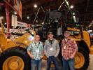 """At the Caterpillar booth with a Cat 918M wheel loader is the crew from Crow River Construction of New London, Minn. (L-R): Owner Kraig Hanson, Equipment Operator Jacob Bengson and Estimator Devon Lien. Hanson said that he buys his company's Cat equipment from Ziegler Cat in Bloomington, Minn. """"They offer great equipment, great parts and service,"""" he said. """"We are really happy with our Cat Equipment and push it hard in the field."""""""