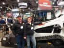 """Rick and Robin Nation from Springfield, Ore., Nation's Mini-Mix, a small yardage concrete specialist, are checking out the new Bobcat T595 track loader. """"This is a great show for concrete people like us,"""" said Rick. """"Great equipment and lots to see."""""""