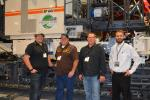 The team from Powder River Construction in Gillette, Wyo., stopped by the huge Wirtgen Group display to check out the SP 64i slipform paver. (L-R) are Lance Walker, Mike Gross and Chad Heidrich, all of Powder River, and Wirtgen Concrete Paving Product Specialist Russell Perry.