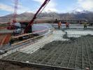 Once the Geofoam embankment was built, a concrete load distribution slab was poured directly on top of the Geofoam.