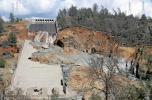Damage to the spillway.