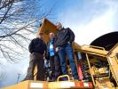 Checking out the specs of this Tigercat are (L-R) Frank Chandler, owner and CEO of C&C Logging, Kelso, Wash.; Ken Grein, design engineer who helped design the Tigercat; and Tim Paul, C&C equipment operator.