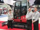 (L-R): Takeuchi's Tammie Snodgrass, David Caldwell and Dean Hoffman were talking up the company's E-240 Green Machine compact excavator, which will be launched soon.