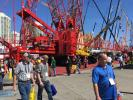 (RM) MNSW (Manitowoc) Many attendees stopped by to take a look at the Manitowoc MLC650 crane — a 650-ton giant, featuring a 479-ft. boom and a 400-ton counterweight.
