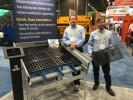 Polydeck Screen Corporation in Greenville, S.C., displayed its 4-ft. section Kwideck Screens that feature quick and easy installation. Showing a sample are Kevin Moore (L) and Brian Cody.