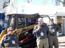 (PK) MNSW (ASV MUST RUN) Speaking to the media in front of an ASV RT-75 outfitted with the brush-guarding package is CEO Andrew Rooke (C), while Steve Gatti (L), national sales manager, and Bill Wake, director of product development, all of ASV, look on.
