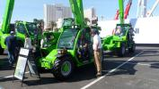 Travis Morrow (R) of GSE&E speaks with Tom Brlyeat of Tom's Tree Removal about the Merlo telehandlers.