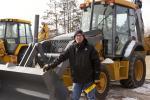 Joseph Leverty of Ogilvie, Minn., inspects this 2008 John Deere 310SJ backhoe
