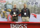 Mike Mindok (L) and Steve Grunlund, both of Boss Snowplow, talk about snow and ice removal at the show