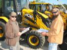 Timothy Moore (L), Moore's Road & Land Maintenance, Ridgeland, S.C., and Brock Burnett, Burnette Construction Services, Ridgeland, S.C., compare notes about some of the new JCB backhoe loaders about to go on the auction block.