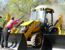 Fuller's Quality Mobile Pressure Cleaning knocks the dust off of the new JCB machines for sale at the auction.