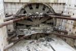 And there she is!: Bertha, the SR 99 tunneling machine, breaks into her disassembly pit.
