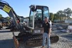 Matt Mortellaro of Moyer Trucks & Equipment, Seffner, Fla., tries out this Terex TC75 excavator before bidding started.