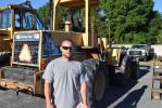 Troy Boutwell of APT, Brooksville, Fla.,considers bidding on this Komatsu WA180 wheel loader.