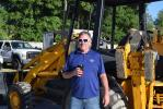 Glen Stocker of American Diesel & Hydraulics, Dunnellon, Fla., shows interest in this JCB backhoe at the auction.
