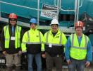 (L-R): AGGCORP's Roberto Armbruster discusses new Powerscreen equipment with Tim Perrin, Dan King and Mark Perrin, all of PK Crushing.