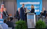 Mandy Brawley, Deputy Director of Global Business for the South Carolina Department of Commerce, presents Atlas Copco AB President and CEO Mats Rahmstrom with a gift during the speeches portion of the grand opening of the Atlas Copco production facility in Rock Hill, South Carolina, Wednesday, May 17, 2017.