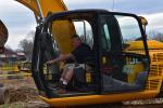 Darren Irvine, heavy equipment operator of Pennsbury School District, tries out this JCB excavator.