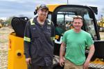 Chris Bachman (L), Earthborne technician, and Chris Zeek, owner of Christopher Zeek Landscape Design and Construction, talk JCB equipment during the Demo Day.