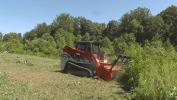 A Takeuchi TL12V2 track loader with a Fecon mulching head