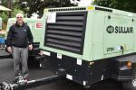 Bill Taromino, area sales manager of Sullair, spoke with customers about his company's 375H portable air compressor.