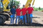 (L-R): Bruce Coston, Danny Hennighan, Nicholas Coston and Chris Zurbach, all of B G Coston & Sons LLC, Franklin, N.J., take time for a photo in front of a Kobelco SK170LC excavator during Harter Equipment's 50th Anniversary Open House.