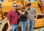 (L-R): Joey Coulter of Erichar Inc's Florida branch talks with Dana Campbell and Charlie Denallo of Erichar Inc.'s Ohio Branch to check out the equipment up for bid.