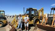 Ivan (L) and Martin Valkov, both of Desert Auto Sales, Las Vegas, usually specialize in the business of selling cars. They came to Ritchie Bros. to help a customer find a loader. This Caterpillar 416B 4x4 loader backhoe stood out among the pack.