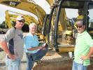 (L-R): Scott Kelly, Strack Inc., Fairburn, Ga., and Tony Kelly and Alan Pratt, both of MA-JAC Underground, Sharpsburg, Ga., talk about some of the machines at  the auction.