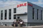 The ABLE sales team: (L-R, on stairs) are Joe Leinwol, Ryan Hubschmitt, Nick Webb, Matt Cohan, Jim Bruno and Jonathan Fieles. (L-R, front row) are Heli Howe, Frank Szyskowski, Lou Sordini, Chris Esposito, Rich Mummendey, Rob Bowser, Juan Diaz and Dino Kalogeropolous.