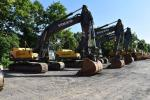 Volvo excavators are lined up and ready for new owners.