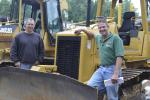 Rob Lodge (L), owner of Lodge Earthworks LLC, Windsor, Conn., and Richard Roulston, owner of Roulston Services LLC, Windsor Locks, Conn., examine this dozer.