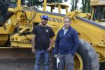 Bobby Bimentel (L) of Bergdoll Construction, Longmeadow, Mass., and Mike Bergdoll, owner of Bergdoll Construction, are interested in this Volvo motorgrader.