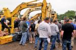 The crowd swarmed in to bid on the excavators. This Komatsu sold for $190,000.
