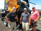 (L-R): Kurt Schwartz of KM International speaks with Shane Slaven and Troy Landers of Delaware County about his company's KM T2 asphalt recycler.