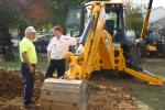 A JCB works on a pile of dirt at a previous event.