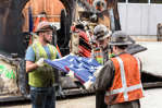 After lifting the final piece of the SR 99 tunneling machine from the disassembly pit near Seattle Center, workers folded the American flag in a triangular pattern, honoring a tradition more than 200 years old.