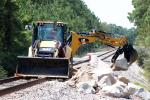 A team member moves riprap into place to protect the slope alongside BNSF track Aug. 31 west of Conroe, Texas, to repair damage caused byHarvey. (BNSF photo)