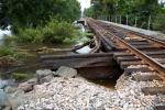 A bridge near Tomball, Texas, on BNSF's Houston Subdivisio,n shows debris Aug. 30 left behind by Harvey. (BNSF photo)