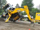 A JCB associate fearlessly shows off just how strong the JCB 4CX backhoe loader really is.