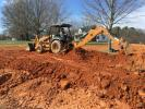 The Case 580 Super M backhoe is digging the lines for the septic tank for a homeowner on Hwy. 11 in Gowensville, S.C.